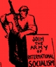 "Cartoon showing an armed worker leaning over a placard which reads ""join the army of international socialism""."