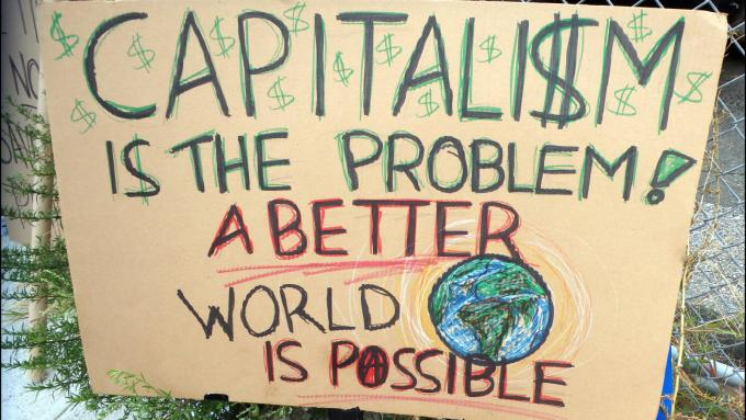 Placard: Capitalism is the problem. A better world is possible.