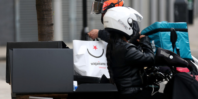 Deliveroo driver with Wagamama