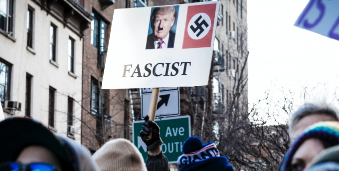 A protestor compares Donald Trump to Hitler (Photo by Chris Boese on Unsplash)