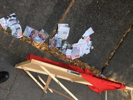 Image of the AWL stall after being overturned, and literature on the floor.