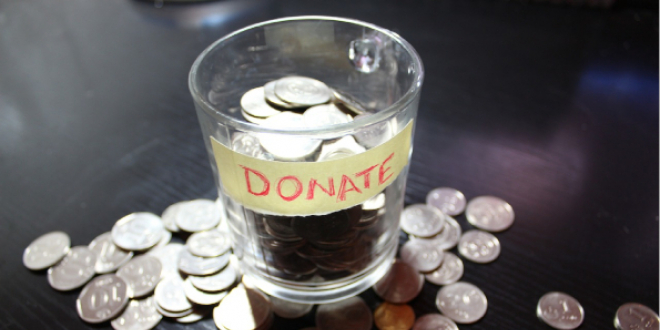 A pot of money with a donate sign
