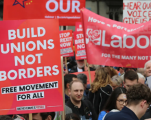 """Build Unions Not Borders"" placard"