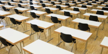 Exam hall full of empty chairs
