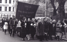 Photo shows marchers with a Union of Post Office Workers banner