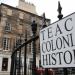 """Teach colonial history"" placard"